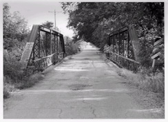black and white photo of a wooden bridge