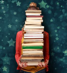Person carrying a stack of books.
