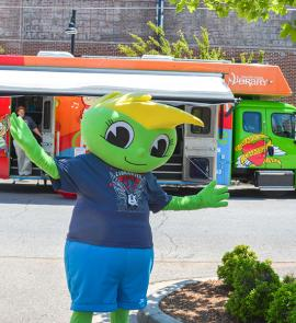 Buddy Bookworm in from of the Bookmobile