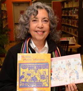 Hispanic author with books