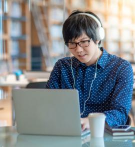 Man with headphones using a laptop