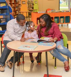 parents and child reading